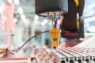 Germany, Stuttgart, Robot in factory - DIGF07205