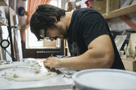 Sculptor working on an object - VPIF01287