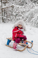 Girl sitting on a sledge - OGF00019