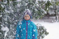 Girl standing in a wintry forest - OGF00022