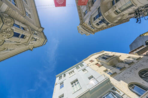Austria, Carinthia, Worthersee, Low angle view of old buildings against clear sky - THAF02514