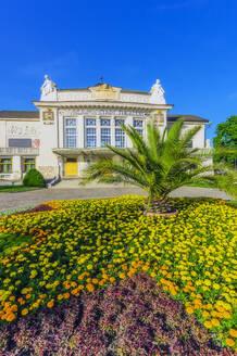 Austria,Carinthia,Klagenfurt,StadttheaterKlagenfurt with flowerbed in foreground - THAF02526
