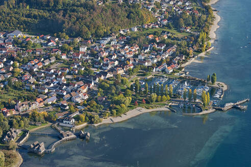 Germany, Baden-Wurttemberg, Aerial view of stilt houses and town on Lake Constance - SHF02196