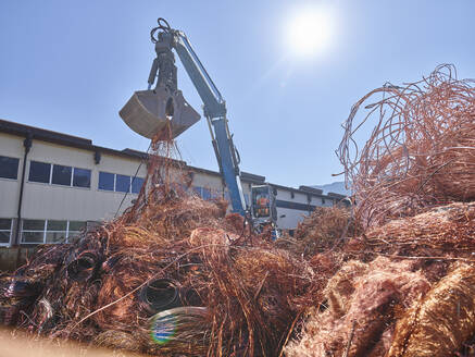 Austria, Tyrol, Brixlegg, Electronic copper wires being recycled in junkyard - CVF01255