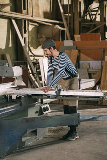 Carpenter working on a saw - VPIF01326