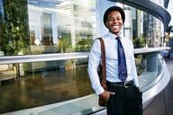 Black businessman smiling outside office building - BLEF09609