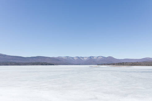 Scenic view of frozen ice on Ashokan Reservoir against clear blue sky - MMAF01078