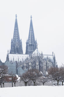 Low angle view of Museum Ludwig and Cologne Cathedral in city against sky - GWF06139
