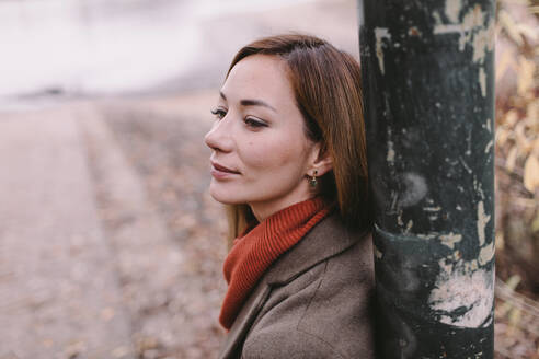 Portrait of relaxed woman in autumn - OGF00047