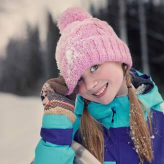 Caucasian teenage girl wearing beanie hat in snow - BLEF09752