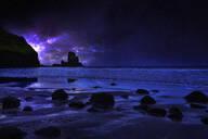 Night sky over rocky Carbost coastline, Isle of Skye, Scotland - BLEF09797
