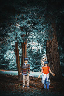 Mixed race children using virtual reality goggles outdoors - BLEF09836