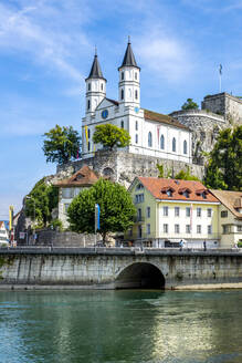 Church and fortress by Aare River in Aarburg against sky - PUF01683