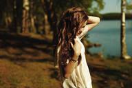Caucasian woman standing near rural lake - BLEF09876