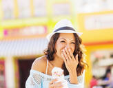 Chinese woman eating ice cream cone - BLEF10097