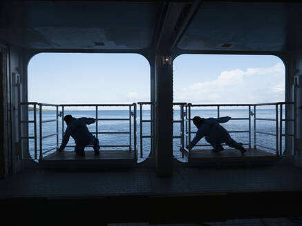 Silhouette male workers on cruise ship platforms - FSIF04042