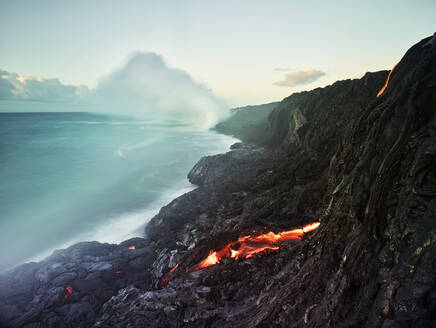 Lava flowing from Pu'u O'o' in sea at Hawaii Volcanoes National Park against sky - CVF01296