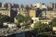 Satellite dishes on roof in residential district - NGF00515