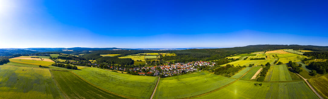 Aerial view over grain fields, meadows, woods and villages, Wetterau, Germany - AMF07203
