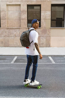 Italy, Tuscany, Florence, Urban Young Man, Mixed Race - MGIF00573