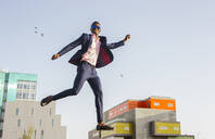 Young businessman jumping mid-air - LJF00466