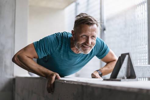 Sporty man making pushups - DIGF07533