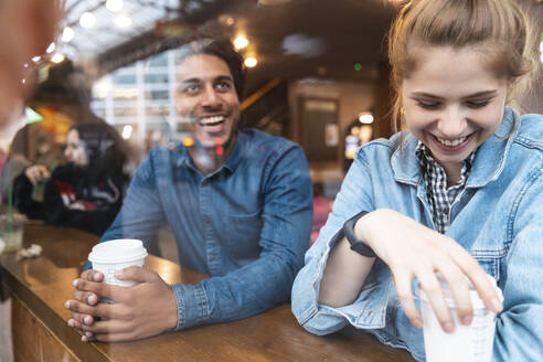 Friends having fun together in a coffee shop - WPEF01614