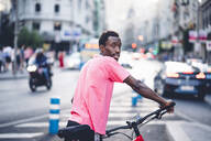 Young man with e bike in the city - OCMF00506