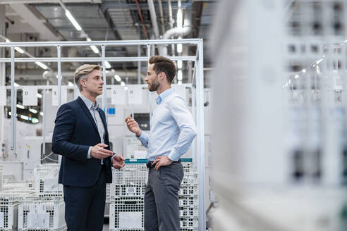 Two businessmen talking in a modern factory - DIGF07581