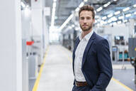 Portrait of a confident businessman in a modern factory - DIGF07605