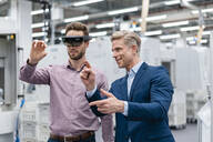 Two businessmen with AR glasses in a modern factory - DIGF07626