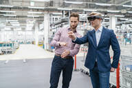 Two businessmen with AR glasses in a modern factory - DIGF07692