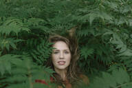 Face of young woman amidst plants - AHSF00597
