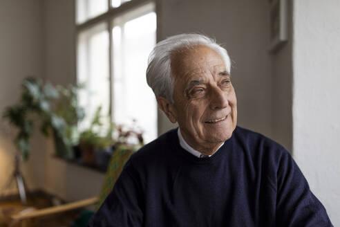 Smiling senior man at home - GUSF02045