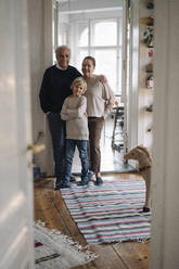 Portrait of happy grandparents with grandson at home - GUSF02201