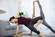Two women practicing yoga at home - SODF00019