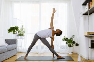 Woman practicing yoga at home - SODF00022