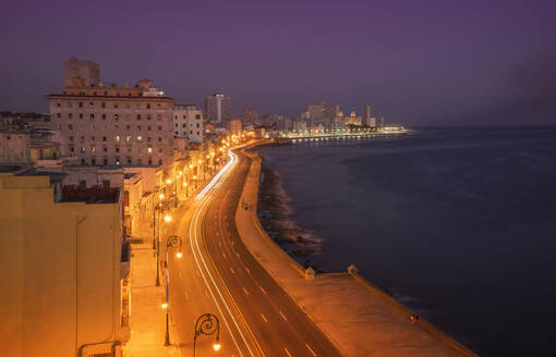 Long exposure of cars on waterfront at night, Havana, Cuba - BLEF10597