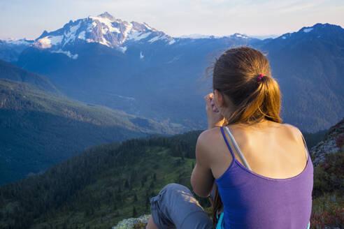 Mixed race girl enjoying view, North Cascade Mountains, Washington, United States - BLEF10889