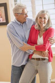 Caucasian couple dancing in living room - BLEF10943