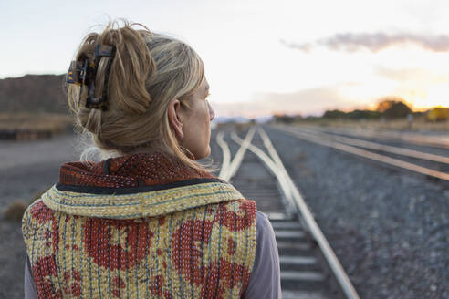 Caucasian woman standing on train tracks - BLEF11045
