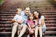 Caucasian family sitting on steps - BLEF11201