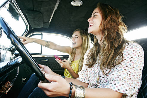 Women driving vintage car - BLEF11465