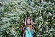 Black woman laying in grass - BLEF11690