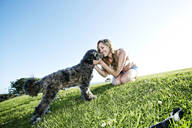Caucasian woman playing with dog - BLEF11702