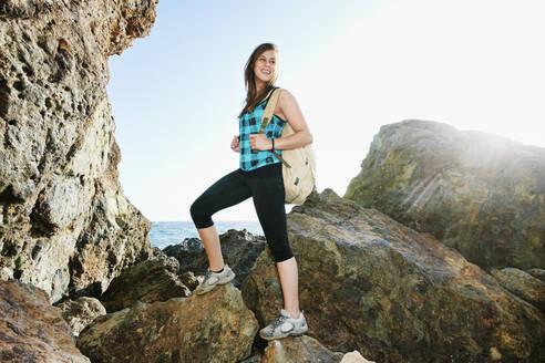 Woman hiking on boulders - BLEF11714