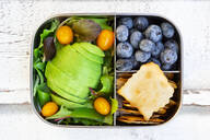 Lunchbox with salad, avocado and yellow tomatoes, crackers and blueberries - LVF08196