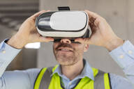 Architect with VR glasses at construction site - ZEF16144