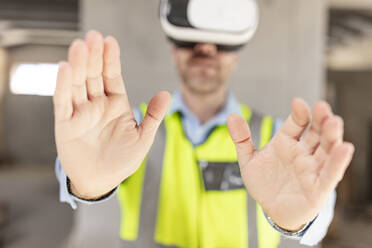 Architect with VR glasses at construction site - ZEF16147