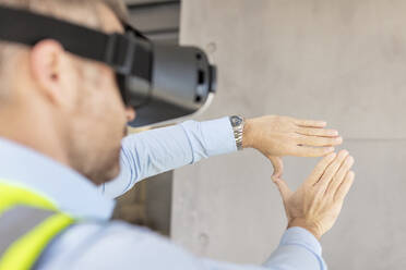 Architect with VR glasses at construction site - ZEF16150